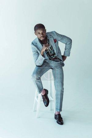 Stylish african american man on bar stool