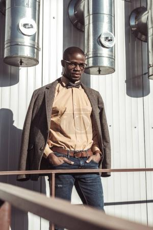 Stylish man posing with hands in pockets