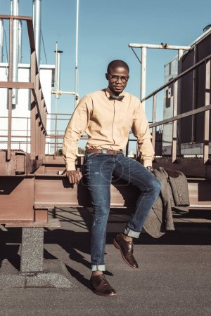 Young african american man on metal construction