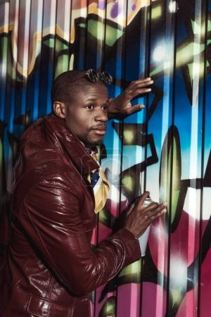 african american man painting graffiti