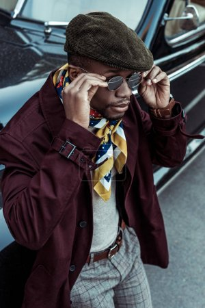 Fashionable man in front of car
