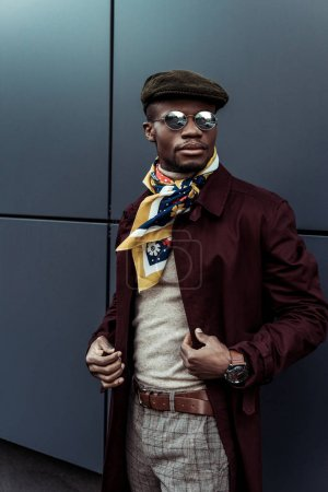 Fashonable man in sunglasses and autumn jacket
