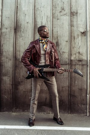 african american man with electrical guitar