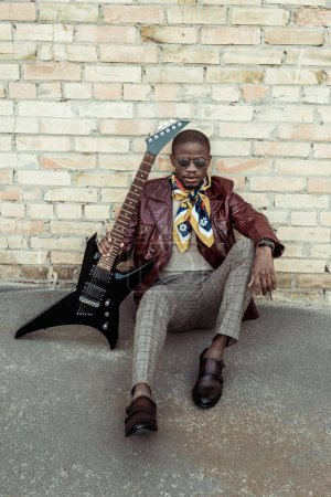 Fashionable african american with guitar