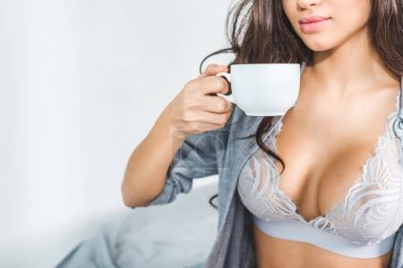 girl in lingerie drinking coffee