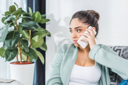 girl using smartphone at home
