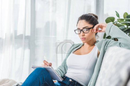 girl with notebook at home