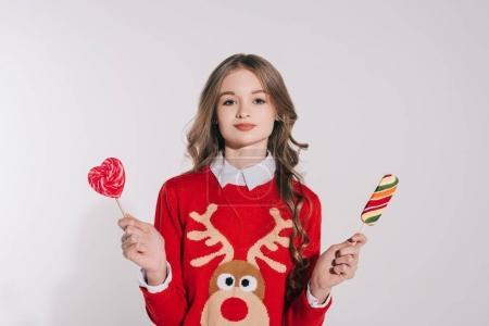 Teenage girl holding candies