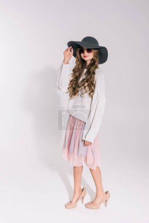 teenage girl in hat and sunglasses