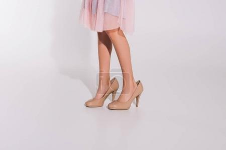 girl in oversized high heeled shoes