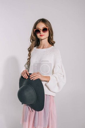 girl in sunglasses with hat