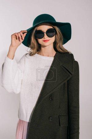 teenage girl in hat and overcoat
