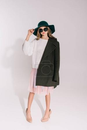 Photo for Full length view of beautiful teenage girl in hat and overcoat posing isolated on grey - Royalty Free Image