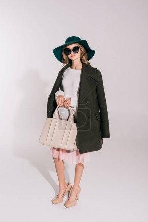 beautiful girl with fashionable handbag