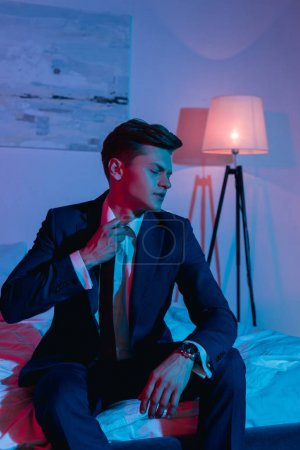 businessman taking off necktie