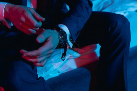 businessman taking off his watch
