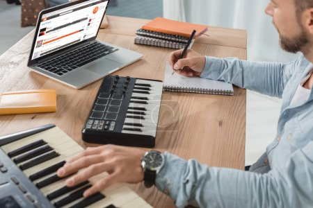 musician working with mpc pads
