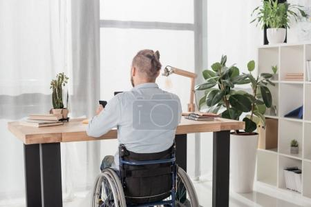 disabled man using smartphone
