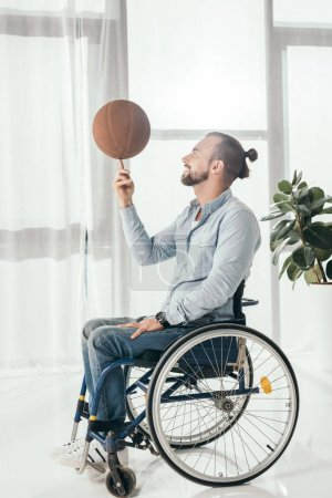 disabled man spinning basketball ball