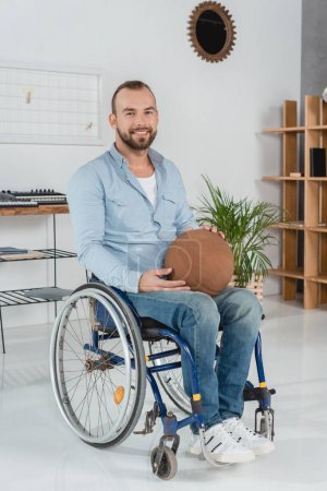disabled man with basketball ball