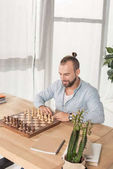 man playing chess with himself