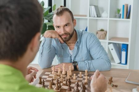 young men playing chess