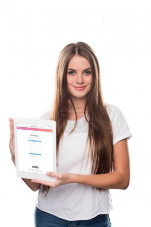 Girl holding tablet with Instagram website