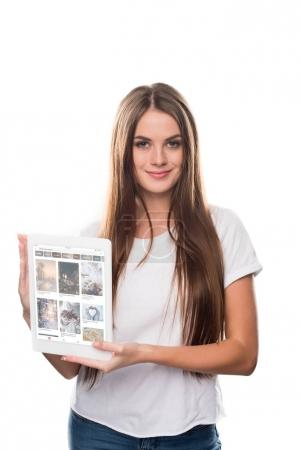 Photo for Girl holding tablet with loaded Pinterest page isolated on white - Royalty Free Image