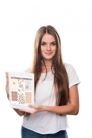 Girl holding tablet with Pinterest website