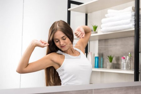 girl stretching in bathroom