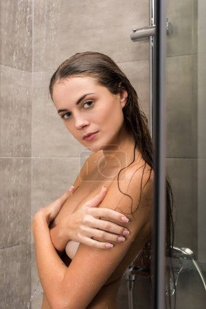 girl covering breast with hands