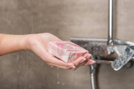girl holding soap in hand