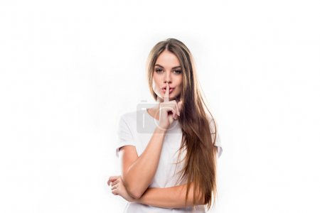 Girl showing silence sign