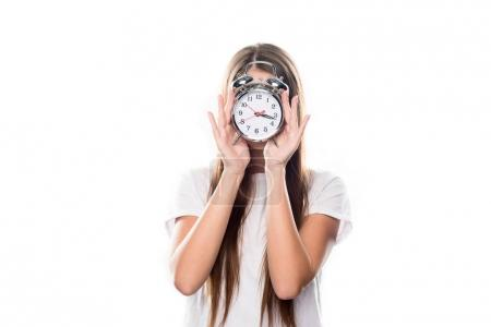 Photo for Girl covering face with alarm clock isolated on white - Royalty Free Image