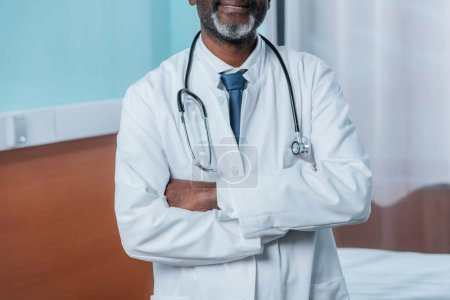 doctor standing with crossed hands