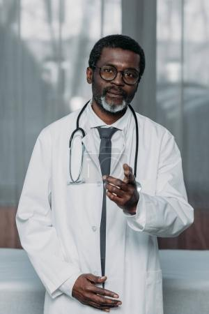 doctor pointing on camera
