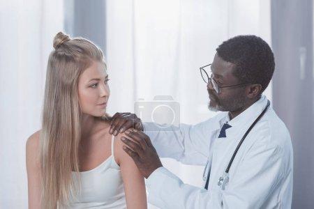 Doctor examining patient shoulder