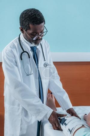 doctor putting on leg brace