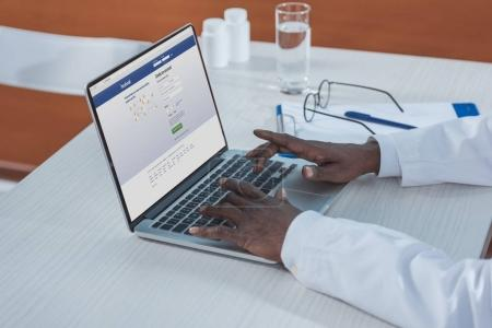 doctor sitting with laptop