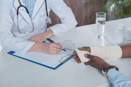 doctor sitting at table with patient