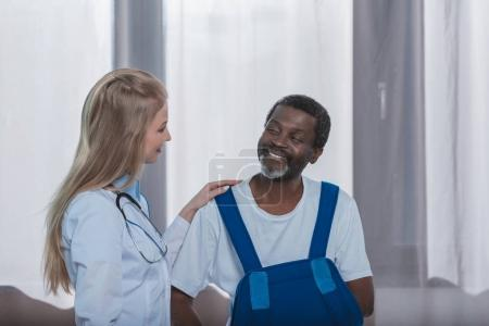 doctor and patient with arm brace