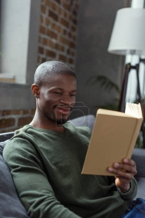 african american man reading book