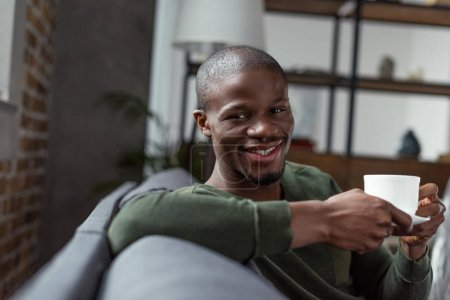 african american man holding cup