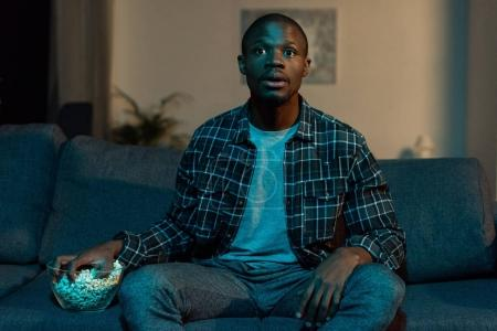 african american man watching tv