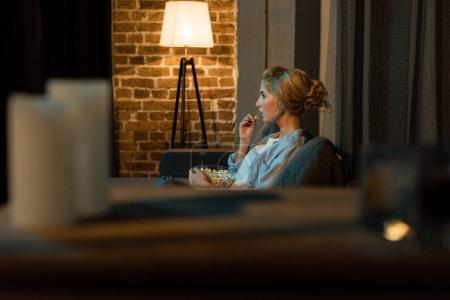 woman watching film at home