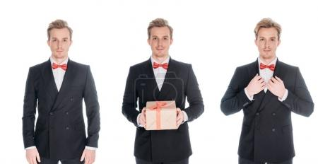 Photo for Handsome young men in stylish suits with present looking at camera isolated on white - Royalty Free Image