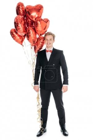 man with heart shaped balloons