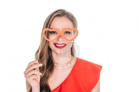 girl with heart shaped glasses on stick