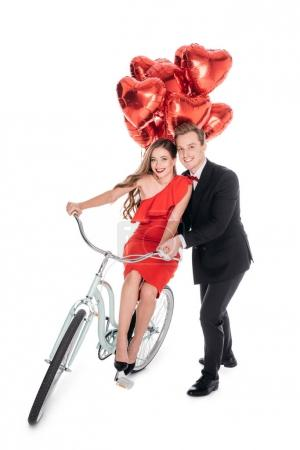 couple with bicycle and balloons