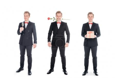 Photo for Stylish young men in suits holding rose flower, gift and glass of champagne isolated on white - Royalty Free Image